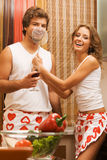 Young romantic couple in the kitchen Royalty Free Stock Image