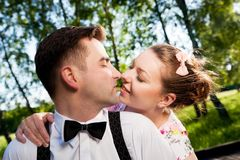 Young romantic couple in love flirting in summer park. Stock Image
