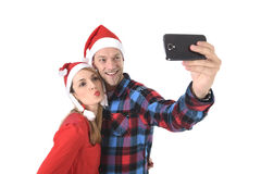 Young romantic couple in love taking selfie mobile phone photo at Christmas Stock Photography