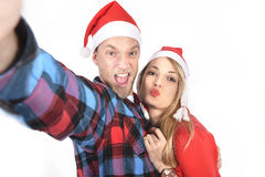 Young romantic couple in love taking selfie mobile phone photo at Christmas Royalty Free Stock Images