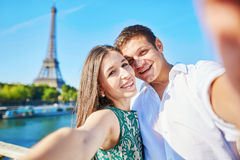 Young romantic couple making selfie near the Eiffel tower Stock Photography