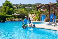 Young romantic couple near swimming pool at exotic Stock Image