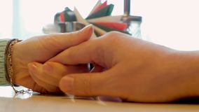 Young romantic couple nervous holding hands on table at cafe boyfriend girlfriend. 4k stock footage
