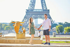Young romantic couple in Paris near the Eiffel tower Royalty Free Stock Photography