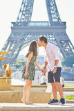 Young romantic couple in Paris near the Eiffel tower Royalty Free Stock Images