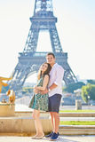 Young romantic couple in Paris near the Eiffel tower Stock Photos