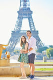 Young romantic couple in Paris near the Eiffel tower Stock Images