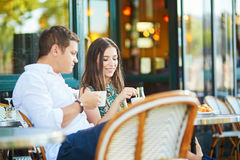 Young romantic couple in Parisian cafe Stock Photography