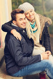Young romantic couple in the park in autumn Royalty Free Stock Photography
