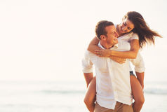 Young Romantic Couple Playing on the Beach Royalty Free Stock Image