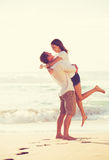Young Romantic Couple Playing on the Beach Royalty Free Stock Photography