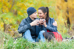 Young romantic couple relaxes on autumn nature Stock Image