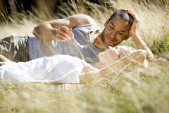 A young romantic couple relaxing on the grass Royalty Free Stock Photography
