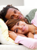 Young romantic couple resting on sofa Royalty Free Stock Image