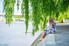 Young romantic couple on the Seine embankment Royalty Free Stock Images