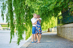 Young romantic couple on the Seine embankment Royalty Free Stock Photo