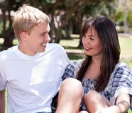 Young romantic couple sitting together Stock Photos