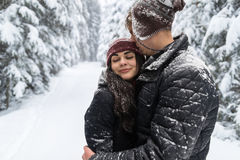 Young Romantic Couple In Snow Forest Outdoor Man And Woman Embrace Stock Photos