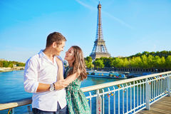 Young romantic couple spending their vacation in Paris, France. Dating couple posing near the Eiffel tower Stock Photography