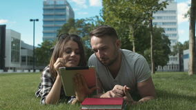 Young romantic couple spending time in park with tablet. stock video footage