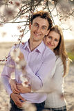 Young romantic couple in spring blossom Stock Photos
