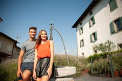 Young romantic couple standing on a garden near lavender plants.  royalty free stock images