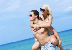 Young and romantic couple on a summer beach Royalty Free Stock Photo