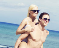 Young and romantic couple on a summer beach Royalty Free Stock Images