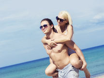 Young and romantic couple on a summer beach Royalty Free Stock Photos