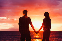 Young Romantic Couple at Sunset. Silhouette of Young Romantic Couple at Sunset Royalty Free Stock Image