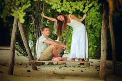 Young romantic couple swinging Royalty Free Stock Images