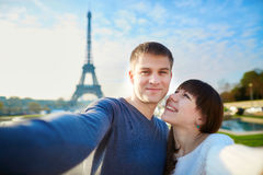 Young romantic couple taking funny wide angle selfie Stock Photos
