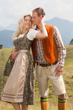 Young romantic couple in traditional Bavarian costumes Royalty Free Stock Photo