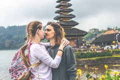 Young romantic couple of trourists on the Ulan Danu temple background. Bali island. Indonesia royalty free stock photography