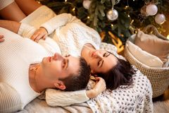 Young romantic couple waiting for new year and Christmas holiday, beautiful bokeh royalty free stock image