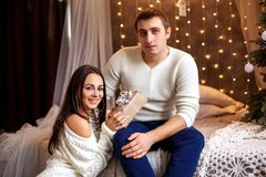 Young romantic couple waiting for new year and Christmas holiday, beautiful bokeh stock photo