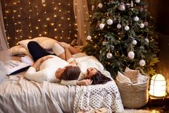 Young romantic couple waiting for new year and Christmas holiday, beautiful bokeh stock photos