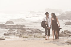 Young romantic couple walking long beach. Through mist Royalty Free Stock Photos