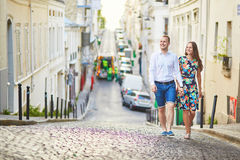 Young romantic couple walking on Montmartre Royalty Free Stock Photo