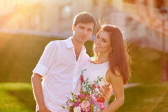 Young romantic couple walking in the summer park Stock Images