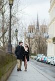 Young romantic couple walking in Paris royalty free stock images