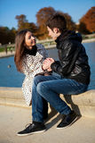 Young romantic couple at warm sunny autumn day. Young romantic couple near water at warm sunny autumn day royalty free stock image