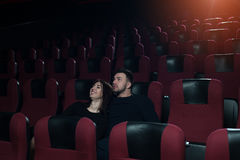Young romantic couple watching movie in theater Royalty Free Stock Photo