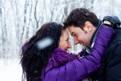 Young romantic couple in winter park Royalty Free Stock Image