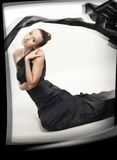 Young romantic girl in black silk clothing stock image