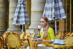 Young romantic girl in Parisian cafe Stock Images