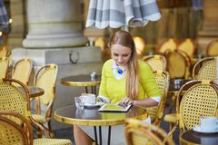 Young romantic girl in Parisian cafe Royalty Free Stock Image