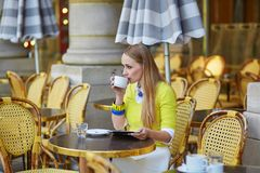 Young romantic girl in Parisian cafe Royalty Free Stock Photos
