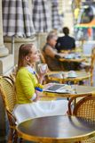 Young romantic girl in Parisian cafe Stock Image
