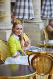 Young romantic girl in Parisian cafe Stock Photo